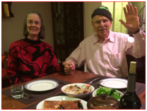 elderly man and woman at dinner