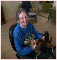 seated elderly lady with dog