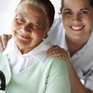 Elderly lady with caregiver